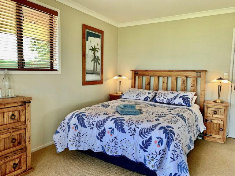 Tui Wing accommodation - bedroom with double bed