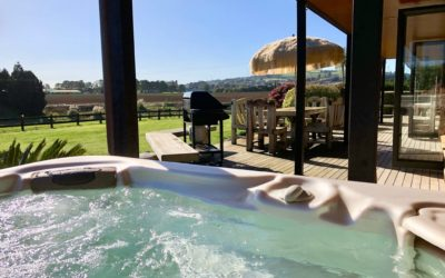 Spa pool with view of Bombay Hills